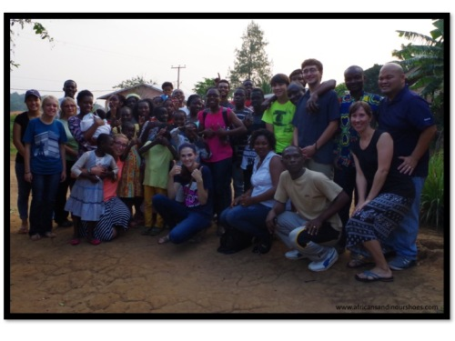 Our team, along with the children at Mama Regine's home.